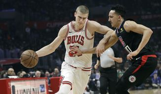 Chicago Bulls' Lauri Markkanen, left, is defended by Los Angels Clippers' Landry Shamet during the first half of an NBA basketball game Friday, March 15, 2019, in Los Angeles. (AP Photo/Marcio Jose Sanchez)