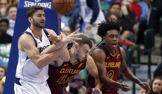 Dallas Mavericks forward Maximilian Kleber (42) competes for the ball with Cleveland Cavaliers center Ante Zizic (41) and guard Collin Sexton (2) during the first half of an NBA basketball game in Dallas, Saturday, March 16, 2019. (AP Photo/Michael Ainsworth)