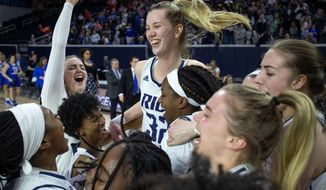 Rice center Nancy Mulkey (32) celebrates with her teammates after defeating Middle Tennessee 69-54 in an NCAA college basketball game in the championship game of the Conference USA women's tournament, Saturday, March 16, 2019, in Frisco, Texas. (AP Photo/Jeffrey McWhorter)