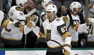Vegas Golden Knights left wing Max Pacioretty (67) is congratulated by the bench after scoring against the Dallas Stars in the first period of an NHL hockey game in Dallas, Friday, March 15, 2019. (AP Photo/Tony Gutierrez)