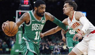 Boston Celtics' Kyrie Irving, left, drives past Atlanta Hawks' Trae Young during the first half of an NBA basketball game in Boston, Saturday, March 16, 2019. (AP Photo/Michael Dwyer)