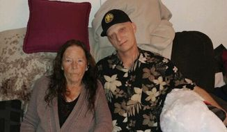In this 2018 photograph released by lawyer Mark Zaid, Michael R. White, right, is seen with his mother, Joanne White, left. White, a U.S. Navy veteran from California, has been sentenced to 10 years in prison in Iran, his lawyer said Saturday, March 16, 2019, becoming the first American known to be imprisoned there since President Donald Trump took office. (White family via AP)