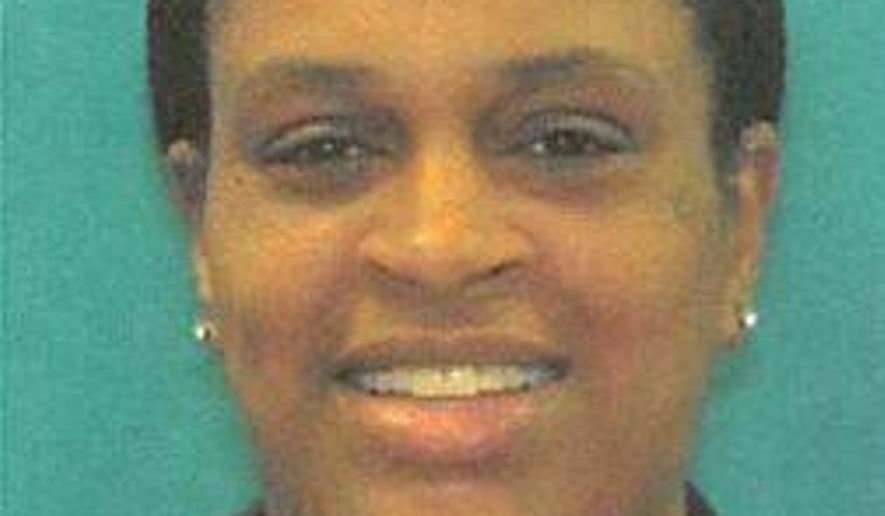 """This undated """"Wanted"""" image shows Kimberly Akisha Lingham-Bailey, 37, of Philadelphia who Delaware State Police say is a suspect in a multi-state shoplifting ring that stole thousands in merchandise from high-end department stores. The Delaware State Police said in a news release Friday March 15, 2019, that warrants have been taken out charging Bailey with felony shoplifting. (The Delaware State Police via AP)"""