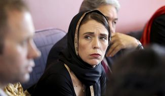 In this photo released by New Zealand Prime Minister's Office, Prime Minister Jacinda Ardern, center, meets representatives of the Muslim community, Saturday, March 16, 2019, at the Canterbury Refugee Centre in Christchurch, New Zealand. (New Zealand Prime Minister Office via AP)