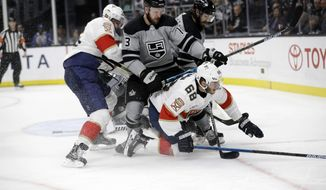 Florida Panthers' Mike Hoffman (68) collides with Los Angeles Kings' Kyle Clifford (13) during the third period of an NHL hockey game Saturday, March 16, 2019, in Los Angeles. (AP Photo/Marcio Jose Sanchez)
