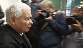 In this file photo taken Oct. 21, 2018, in Warsaw, Poland, is seen Poland's right-wing ruling party leader Jaroslaw Kaczynski after he cast his ballot in local elections. In his campaign ahead of 2019 parliamentary elections Kaczynski has used hostile language against LGBT rights of marriage and adoption.(AP Photo/Czarek Sokolowski)