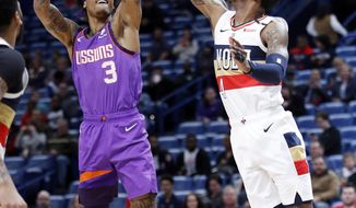 Phoenix Suns forward Kelly Oubre Jr. (3) shoots over New Orleans Pelicans guard Elfrid Payton (4) during the first half of an NBA basketball game in New Orleans, Saturday, March 16, 2019. (AP Photo/Tyler Kaufman)