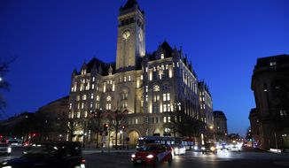 FILE- This Jan. 30, 2018, file photo shows the Trump International Hotel in Washington. A federal appeals court is set to hear arguments in a lawsuit that alleges President Donald Trump is violating the constitution by profiting off the presidency. (AP Photo/Alex Brandon, File)