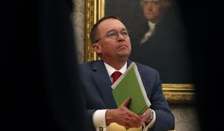 In this Jan. 31, 2019, file photo, acting White House Chief of Staff Mick Mulvaney listens as President Donald Trump speaks during a meeting with American manufacturers in the Oval Office of the White House in Washington. (AP Photo/Jacquelyn Martin) ** FILE **