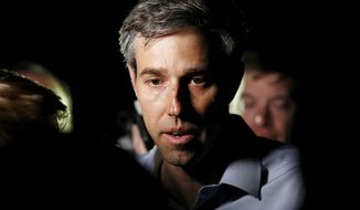 Democratic presidential candidate Beto O'Rourke speaks to reporters after making a campaign stop at the home of Dubuque County Recorder John Murphy in Dubuque, Iowa on Saturday, March 16, 2019./Telegraph Herald via AP)