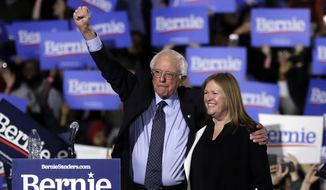 FILE - In this March 3, 2019, file photo, Sen. Bernie Sanders, I-Vt., left, and his wife, Jane Sanders, greet supporters as they leave after his 2020 presidential campaign stop at Navy Pier in Chicago. Bernie Sanders revolution is Jane Sanders career. And her political and business activities have at times been his headache. His closest adviser, she is perhaps the most influential woman in the 2020 campaign who isnt a candidate. (AP Photo/Nam Y. Huh, File)