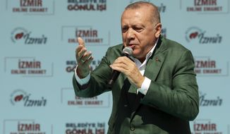 Turkey's President Recep Tayyip Erdogan addresses the supporters of opposition Nationalist Movement Party, MHP, and his ruling Justice and Development Party, AKP, at a joint rally in Aegean city of Izmir, Turkey, Sunday, March 17, 2019. Erdogan's AKP and MHP made an alliance for the countrywide local elections scheduled for March 31, 2019 with 57 million registered voters. (Presidential Press Service via AP, Pool)