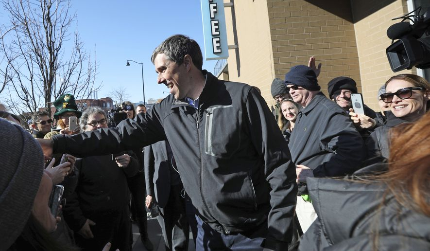 Democratic presidential candidate Beto O'Rourke greets a crowd outside Cargo Coffee on East Washington Avenue during a stop in Madison, Wis., Sunday, March 17, 2019. (AP Photo/Wisconsin State Journal, Amber Arnold)/Wisconsin State Journal via AP)