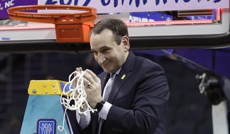 Duke head coach Mike Krzyzewski celebrates Duke's win over Florida State after cutting down a net after the NCAA college basketball championship game of the Atlantic Coast Conference tournament in Charlotte, N.C., Saturday, March 16, 2019. (AP Photo/Nell Redmond) **FILE**