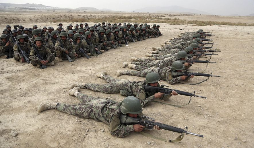 FILE - In this Oct. 31, 2018, photo, Afghan National Army soldiers carry out an exercise during a live firing at the Afghan Military Academy in Kabul, Afghanistan. Afghan officials say around 100 soldiers fled their posts and tried to cross into neighboring Turkmenistan during a weeklong battle with the Taliban, in the latest setback for the country's battered security forces. Mohammad Naser Nazari, a provincial council member in the western Badghis province, said Sunday, March 17, 2019, that the soldiers were not allowed to cross the border and their fate remains unknown. (AP Photo/Rahmat Gul, File)