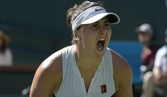 Bianca Andreescu, of Canada, celebrates after winning a game against Angelique Kerber, of Germany, during the women's final at the BNP Paribas Open tennis tournament Sunday, March 17, 2019, in Indian Wells, Calif. (AP Photo/Mark J. Terrill)