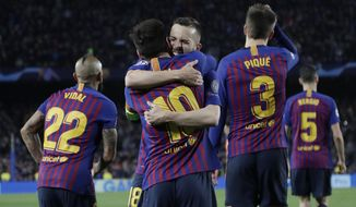 Barcelona's Lionel Messi, centre, is hugged by Jordi Alba after scoring his side's third goal during the Champions League round of 16, 2nd leg, soccer match between FC Barcelona and Olympique Lyon at the Camp Nou stadium in Barcelona, Spain, Wednesday, March 13, 2019. (AP Photo/Emilio Morenatti)