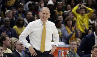 Michigan head coach John Beilein reacts top a call during the first half of an NCAA college basketball championship game against Michigan State in the Big Ten Conference tournament, Sunday, March 17, 2019, in Chicago. (AP Photo/Nam Y. Huh) ** FILE **