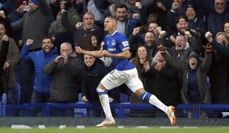 Everton's Richarlison celebrates scoring his side's first goal of the game , during the English Premier League soccer match between Everton and Chelsea at Goodison Park in Liverpool, England, Sunday March 17, 2019. (Martin Rickett/PA via AP)