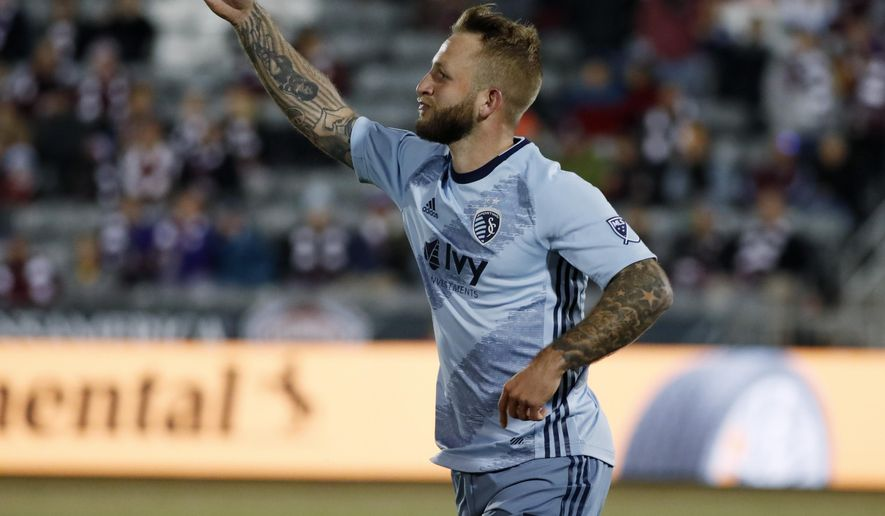 Sporting Kansas City forward Johnny Russell celebrates after scoring the tying goal against the Colorado Rapids during the second half of an MLS soccer match Sunday, March 17, 2019, in Commerce City, Colo. The teams tied 1-1. (AP Photo/David Zalubowski)