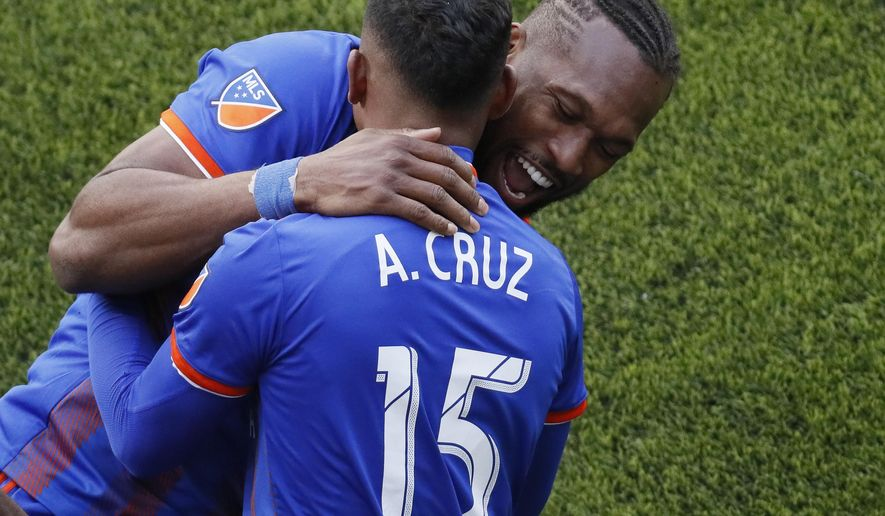 FC Cincinnati midfielder Allan Cruz (15) celebrates his goal with defender Kendall Waston during the second half of an MLS soccer match against the Portland Timbers, Sunday, March 17, 2019, in Cincinnati. (AP Photo/John Minchillo)