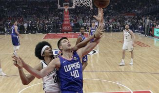 Los Angeles Clippers' Ivica Zubac (40) grabs a rebound next to Brooklyn Nets' Jarrett Allen, left, during the first half of an NBA basketball game Sunday, March 17, 2019, in Los Angeles. (AP Photo/Marcio Jose Sanchez)
