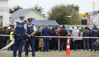 Religious representatives perform a special blessing ceremony on the site of Friday's shooting outside the Linwood mosque in Christchurch, New Zealand, Monday, March 18, 2019. Three days after Friday's attack, New Zealand's deadliest shooting in modern history, relatives were anxiously waiting for word on when they can bury their loved ones. (AP Photo/Vincent Thian)