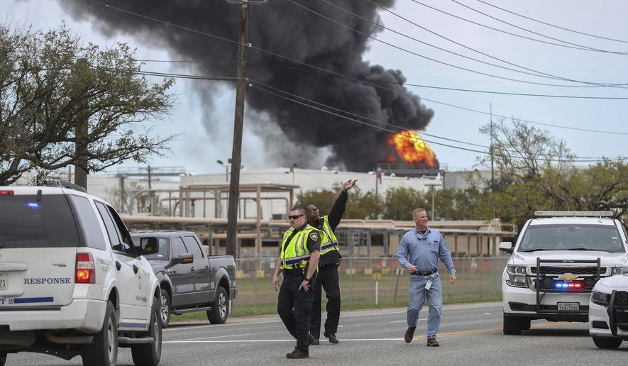 Smoke rises from a fire burning at the Intercontinental Terminals Company in Deer Park, east of Houston, Sunday, March 17, 2019. Some residents in the area are being urged to find a safe location indoors after the fire broke out at the petrochemicals terminal. (Steve Gonzales/Houston Chronicle via AP)