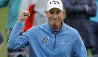 Jim Furyk pumps his fist after making a birdie on the ffifth hole during the final round of The Players Championship golf tournament Sunday, March 17, 2019, in Ponte Vedra Beach, Fla. (AP Photo/Gerald Herbert)