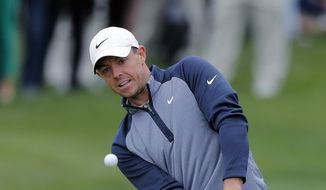 Rory McIlroy, of Northern Ireland, chips to the ninth green during the final round of The Players Championship golf tournament Sunday, March 17, 2019, in Ponte Vedra Beach, Fla. (AP Photo/Gerald Herbert)