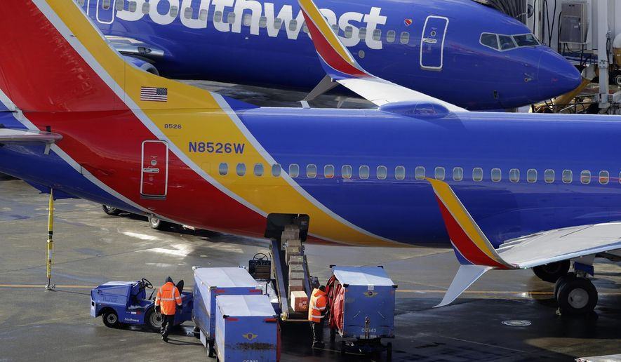 FILE - In this Feb. 5, 2019, file photo, Southwest Airlines planes are loaded at Seattle-Tacoma International Airport in Seattle. Southwest Airlines and a union representing its mechanics say they're on the verge of ending a bitter, long-running labor dispute that has triggered hundreds of flight cancellations and raised safety concerns. The two sides say the breakthrough announced Saturday, March 16, 2019, consists of a preliminary agreement on a new contract after six years of negotiation between Southwest and the Aircraft Mechanics Fraternal Association.  (AP Photo/Ted S. Warren, File)
