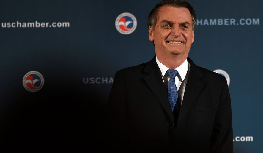 """Known as the """"Trump of the tropics"""" Brazilian President Jair Bolsonaro is set to meet with President Trump for the first time at the White House on Tuesday. (ASSOCIATED PRESS)"""