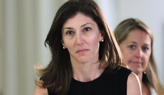 Former FBI lawyer Lisa Page leaves following an interview with lawmakers behind closed doors on Capitol Hill in Washington, Friday, July 13, 2018. (AP Photo/Manuel Balce Ceneta)