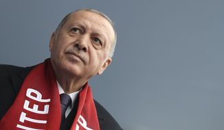 """Turkey's President Recep Tayyip Erdogan delivers a speech at a rally of his ruling Justice and Development Party's (AKP) in Gaziantep, southeastern Turkey, Friday, March 15, 2019, ahead of local elections scheduled for March 31, 2019. Erdogan says at least three Turkish citizens were injured in the attack that targeted Muslim worshippers in New Zealand and that he has spoken to one of them. Turkish media reports said the man had left a 74-page manifesto that among other things, threatened to make Istanbul _ which was called Constantinople before the Ottoman conquest _ """"Christian-owned once more."""" (Presidential Press Service via AP, Pool)"""