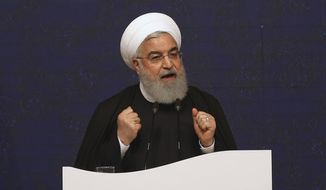 Iranian President Hassan Rouhani speaks during the inauguration ceremony of four projects at the South Pars gas field on the northern coast of the Persian Gulf, in Asaluyeh, Iran, Sunday, March 17, 2019. Iran said the development will allow Iran to overtake Qatar in the production of natural gas. The two countries are among the biggest gas producers in the world and share the South Pars gas field. (AP Photo/Vahid Salemi)