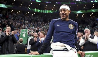 Denver Nuggets guard Isaiah Thomas smiles as his acknowledged by fans during a video tribute during a break the first quarter of an NBA basketball game against the Boston Celtics in Boston, Monday, March 18, 2019. Thomas returned to play in his first game after being traded in 2017 for Kyrie Irving. (AP Photo/Charles Krupa) ** FILE **