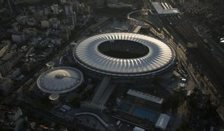 FILE - This June 8, 2014 file photo, shows an aerial view of the Maracana stadium, in Rio de Janeiro, Brazil. Rio de Janeiro's state government announced on Monday, March 18, 2019 that it will take back the control of the crisis-ridden Maracana stadium and break the contract with its private administrators. (AP Photo/Felipe Dana, File)