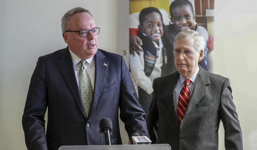 James Carroll, director of the Office of National Drug Control Policy, speaks at Volunteers of America as Senate Majority Leader Mitch McConnell looks on Monday, March 18, 2019 in Louisville, Ky.  (Michael Clevenger/Courier Journal via AP)