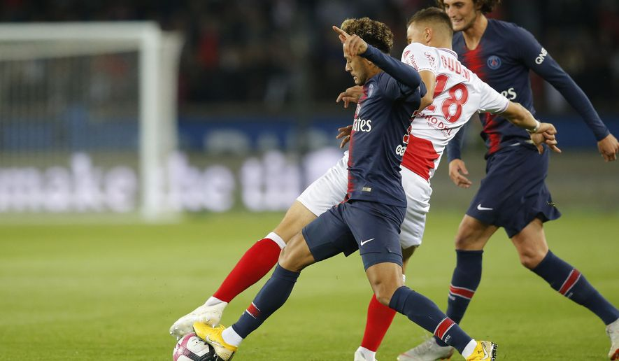 FILE - In this Sept. 26, 20-19 file picture PSG's Neymar, left, fights for the ball with Reims' Remi Oudin during the French League One soccer match between Paris-Saint-Germain and Reims at the Parc des Princes stadium in Paris, France. Fifth-placed Reims's excellent run in the French league is largely due to the performances of 22-year-old Remi Oudin, a versatile attacking midfielder with an impressive left foot and a great touch. (AP Photo/Michel Euler, File)