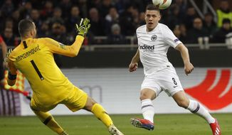 File - In this Thursday, March 14, 2019, file photo, Frankfurt's Luka Jovic, right, scores his side's opening goal during the Europa League round of 16 second leg soccer match between Inter Milan and Eintracht Frankfurt at the San Siro stadium in Milan, Italy. (AP Photo/Antonio Calanni, file)