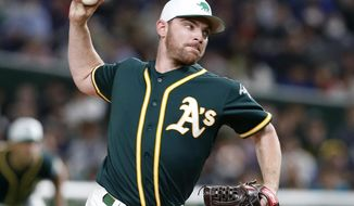 In this Sunday, March 17, 2019, photo, Oakland Athletics starter Liam Hendriks pitches against the Nippon Ham Fighters in the first inning of their preseason exhibition baseball game at Tokyo Dome in Tokyo. Hendriks made the jump from playing tee-ball in Australia to being the opening pitcher last season for the Athletics in the playoffs. (AP Photo/Toru Takahashi)