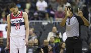 Washington Wizards guard Tomas Satoransky (31), from the Czech Republic, reacts to a foul call from referee Eric Lewis (42) during the first half of an NBA basketball game against the Utah Jazz, Monday, March 18, 2019, in Washington. (AP Photo/Alex Brandon)