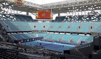 The stadium court in the middle of the field at Hard Rock Stadium at the 2019 Miami Open in Miami Gardens, Florida, Monday, March, 18, 2019.  (Charles Trainor, Jr./Miami Herald via AP)