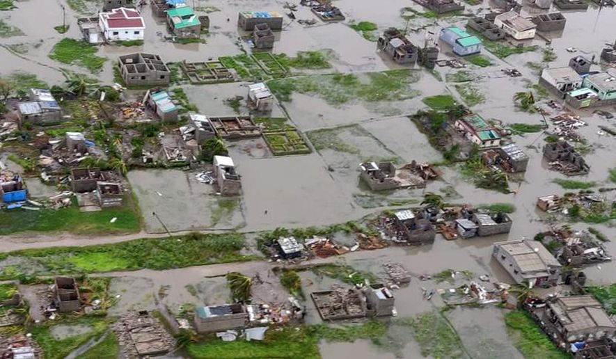 This image made available by International Federation of Red Cross and Red Crescent Societies (IFRC) on Monday March 18, 2019, shows an aerial view from a helicopter of flooding in Beira, Mozambique. The Red Cross says that as much as 90 percent of Mozambique's central port city of Beira has been damaged or destroyed by tropical Cyclone Idai. (Caroline Haga/International Federation of Red Cross and Red Crescent Societies (IFRC) via AP)