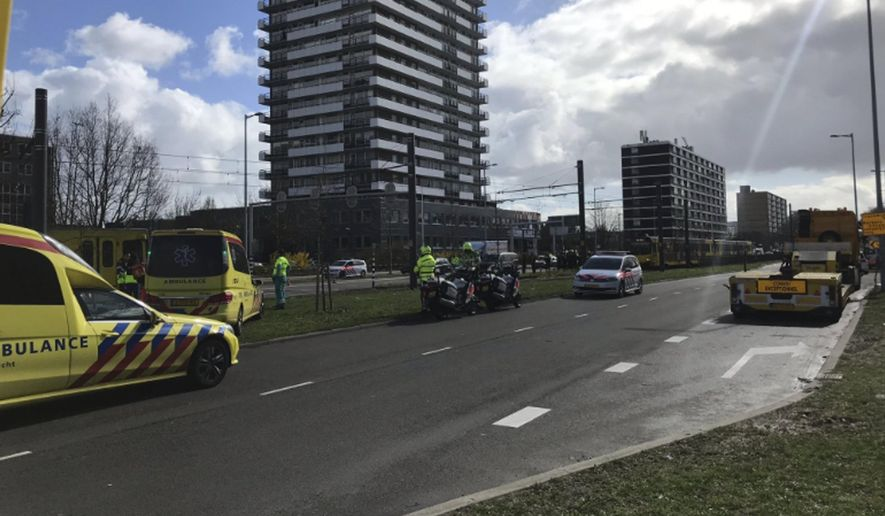 """Emergency services attend the scene of a shooting in Utrecht, Netherlands, Monday March 18, 2019. Police in the central Dutch city of Utrecht say on Twitter that """"multiple"""" people have been injured as a result of a shooting in a tram in a residential neighborhood. (Martijn van der Zande via AP)"""