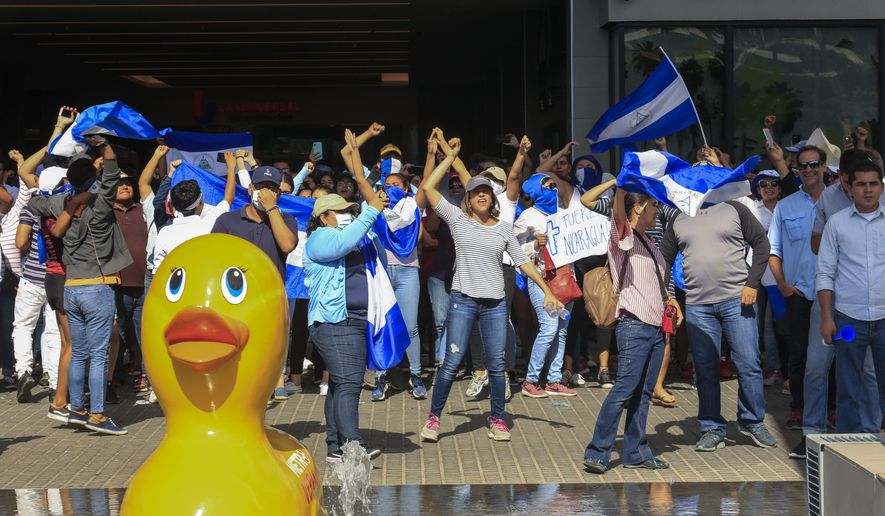 Demonstrators chant during a protest demanding the government release hundreds of protesters held in custody since 2018, in Managua, Nicaragua, Saturday, March 16, 2019. Nicaragua's government banned opposition protests in September and police broke up Saturday's attempt at a demonstration. (AP Photo/Alfredo Zuniga)