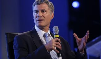 FILE- In this May 14, 2014, file photo Alan Krueger, professor of economics and public affairs at Princeton University, speaks at the 2014 Fiscal Summit organized by the Peter G. Peterson Foundation in Washington. Princeton University Professor Krueger, a groundbreaking economist who served as a top adviser, has died according to a statement by the university. (AP Photo, File)