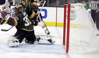The Edmonton Oilers score on Vegas Golden Knights goalie Malcolm Subban during the third period of an NHL hockey game Sunday, March 17, 2019, in Las Vegas. The Golden Knights won, 6-3. (AP Photo/Isaac Brekken)