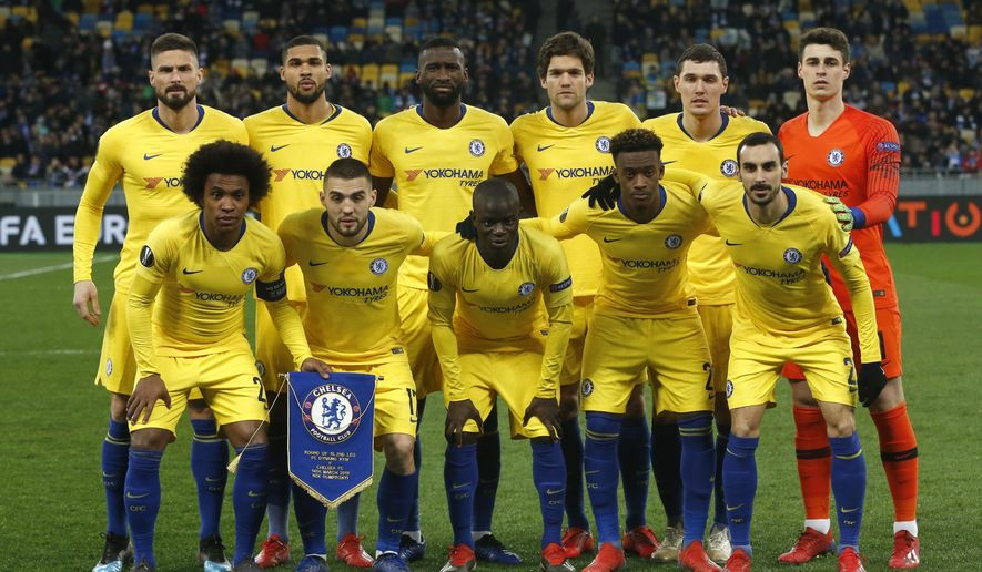 Chelsea starting players pose for a team photo at the beginning of the Europa League round of 16, second leg soccer match between Dynamo Kiev and Chelsea at the Olympiyskiy stadium in Kiev, Ukraine, Thursday, March 14, 2019. (AP Photo/Efrem Lukatsky)