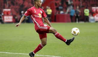 FILE - In this Sept. 22, 2018, file photo, New York Red Bulls midfielder Tyler Adams kicks the ball against Toronto FC during the second half of a soccer game in Harrison, N.J. New U.S. coach Gregg Berhalter announced a surprising position change after his first training session with the full American player pool, shifting Adams to right back and DeAndre Yedlin to wide midfield. (AP Photo/Julio Cortez, File)